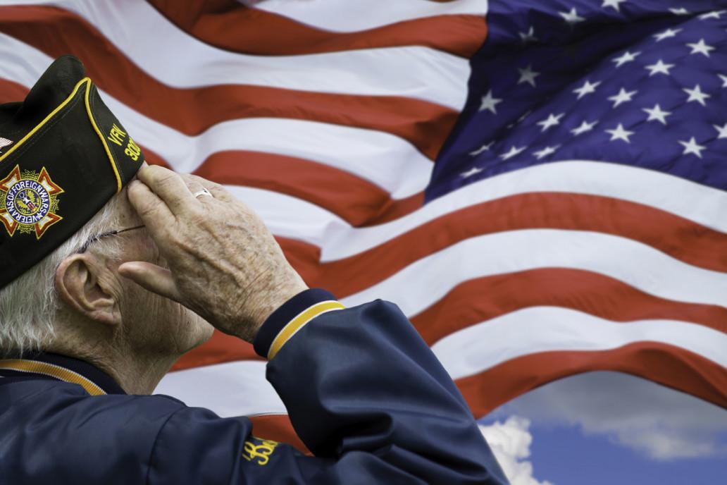 we salute you elderly vet saluting the American flag we salute you volunteers volunteer manager Our care volunteer program Endless Journey Hospice Omaha Nebraska active duty