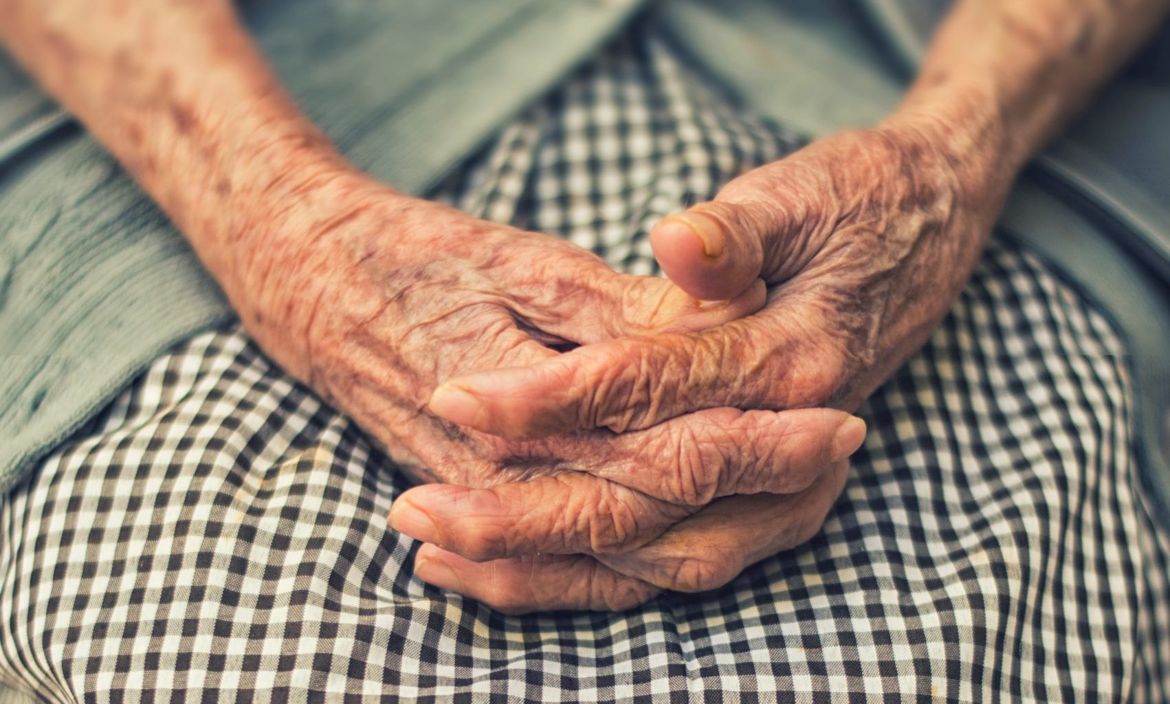 elderly women's hands our care non-profit hospice house Endless Journey Hospice Omaha Nebraska