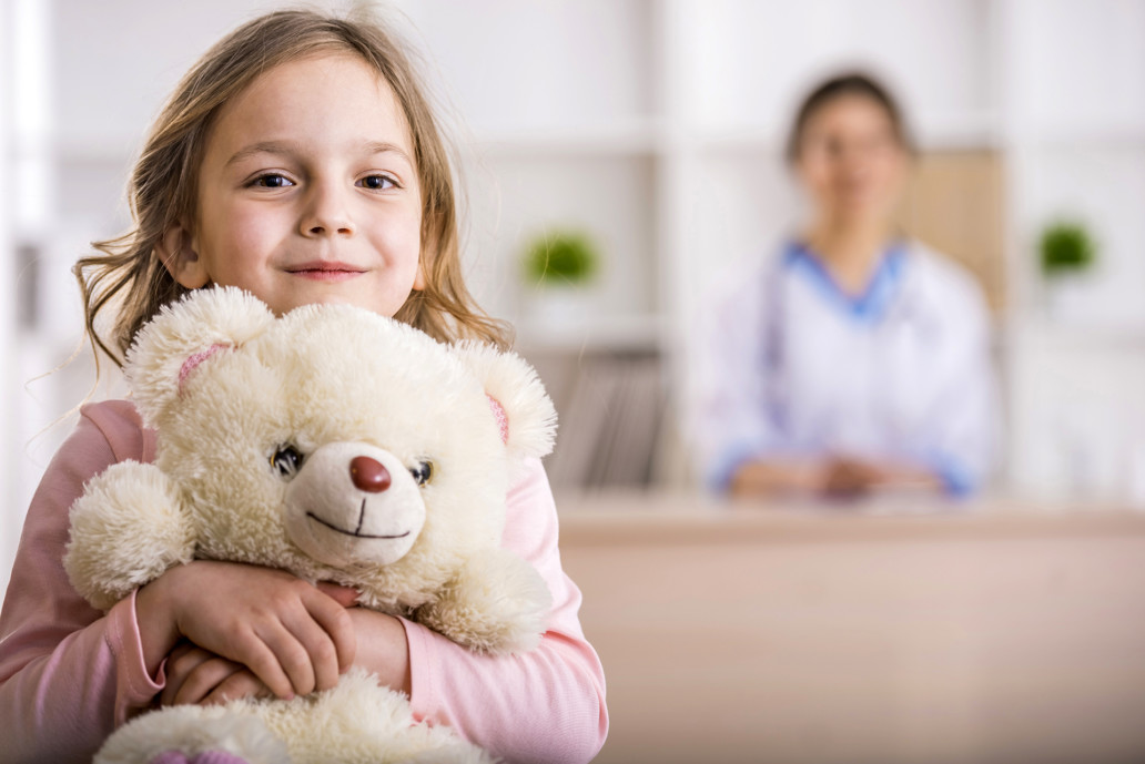 girl with teddy bear relief of symptoms pediatric our clients Endless Journey Hospice Omaha Nebraska
