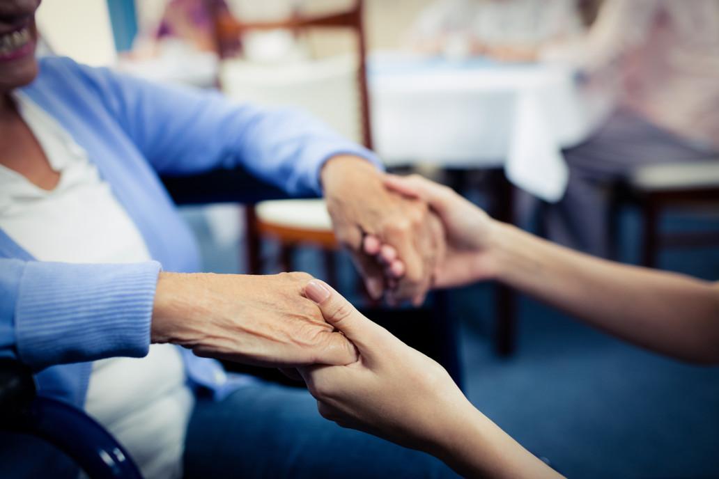 people holding hands non-profit hospice house Endless Journey Hospice Omaha Nebraska