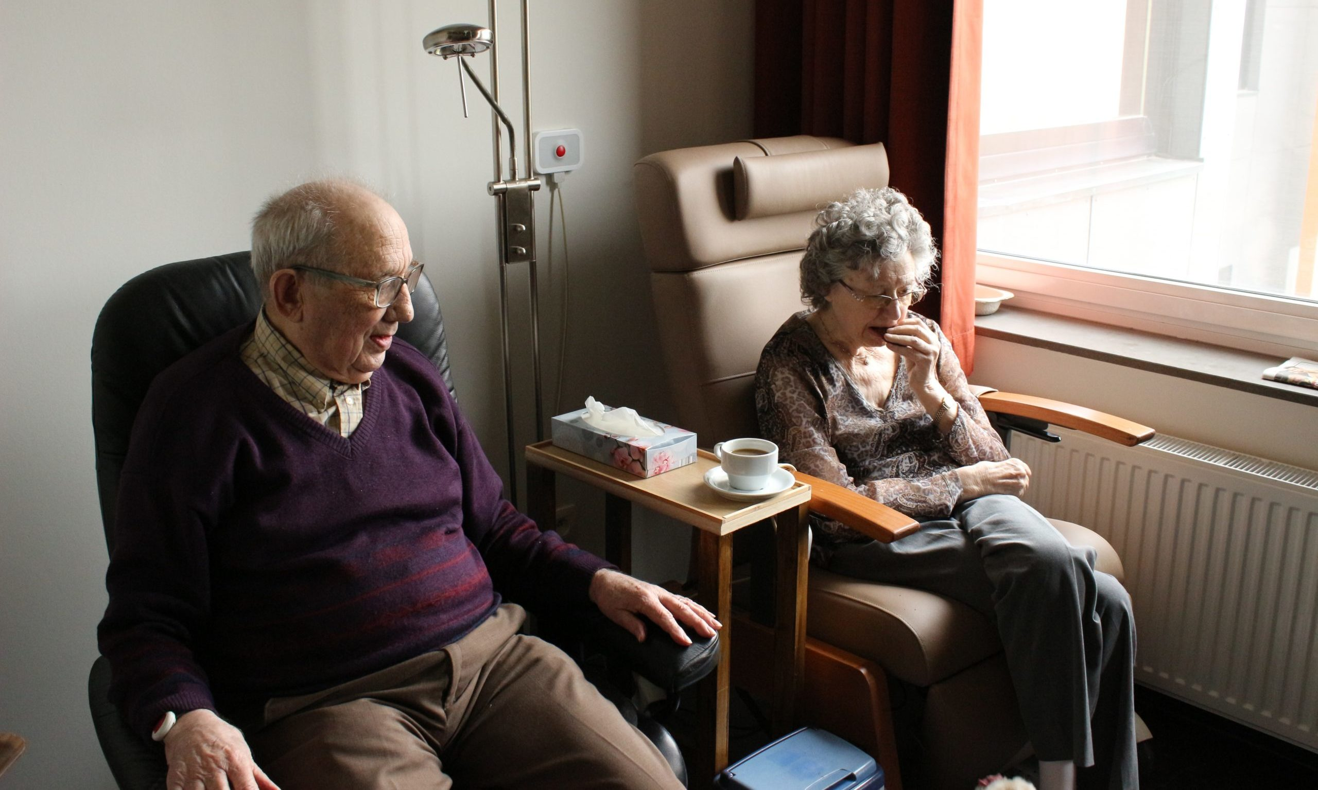 elderly couple sitting by window geriatric our clients Endless Journey Hospice Omaha Nebraska