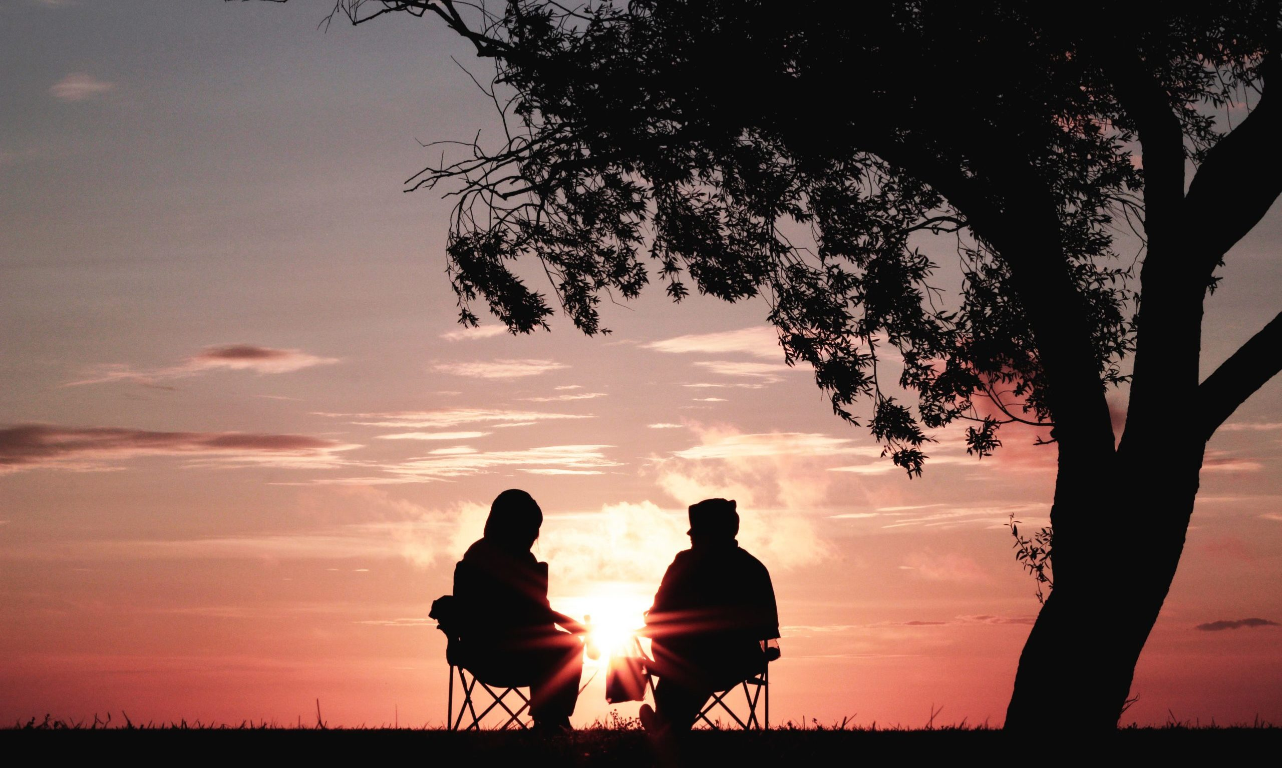 two people watching the sunset our care psychosocial support Endless Journey Hospice Omaha Nebraska