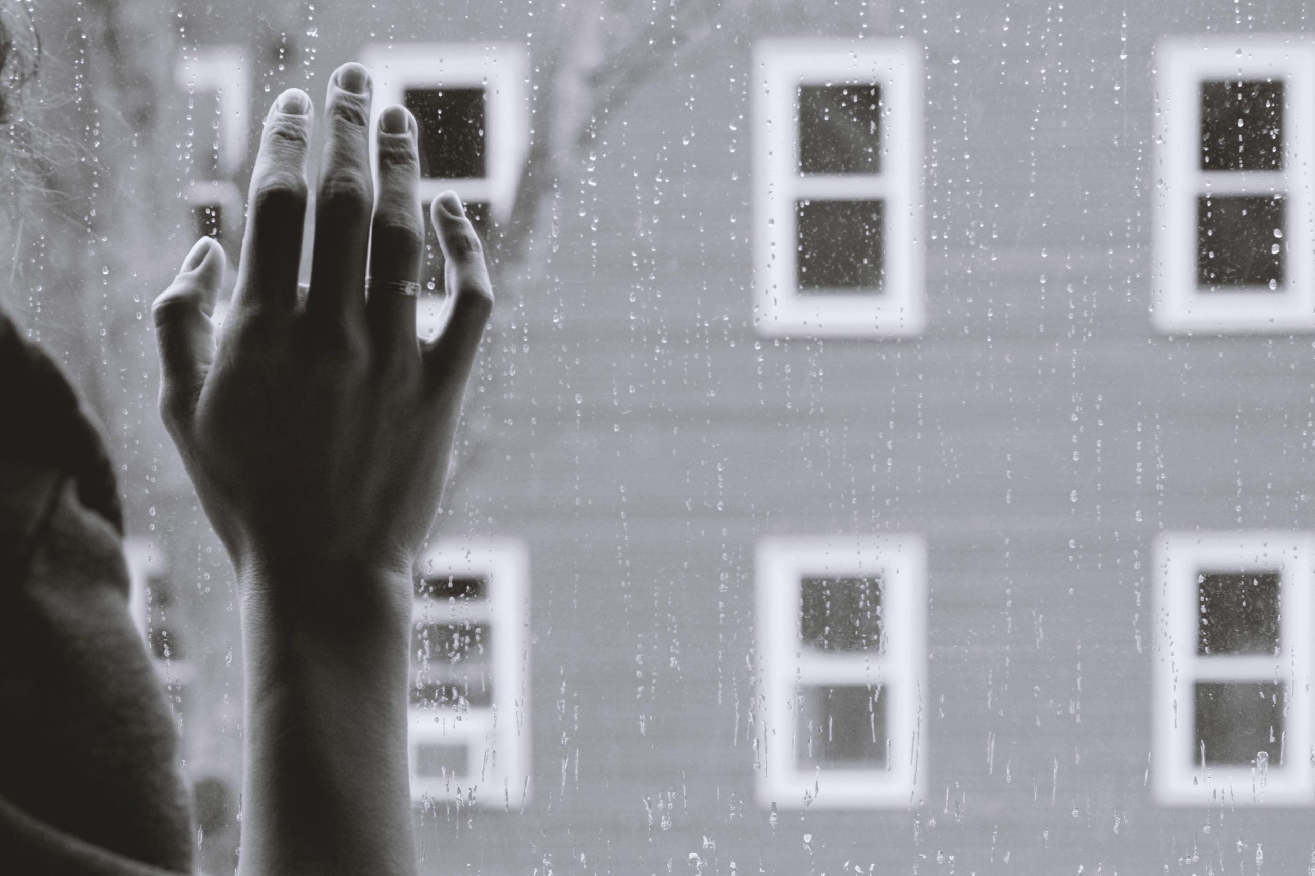 hand on window while raining bereavement services grief support Endless Journey Hospice Omaha Nebraska